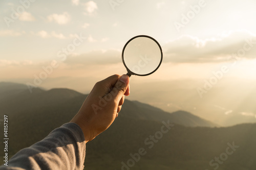 Hand hold magnifying glass,Searching concept,Business success research concept,T Canvas Print