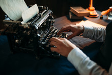 Literature Author In Glasses Typing On Typewriter