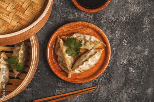 Stickers pour porte Pierre, Sable Fresh dumplings on a dark stone background.