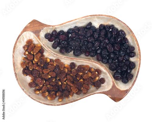 Photo Dried organic golden berries, Physalis Peruviana and whole organic dried cranber