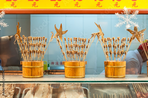 Scorpions on sticks and other weird snacks at Wangfujing snack street, Beijing