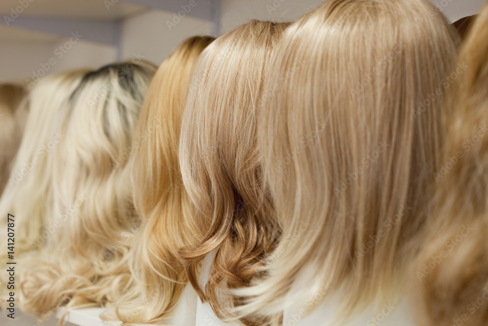 Fototapeta Row of Mannequin Heads with Wigs