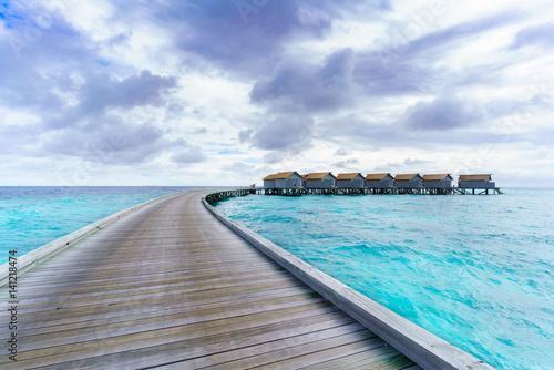Luxury water villas in tropical Maldives island