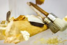 Tools For A Gilding Furniture With Golden Leaf In Workshop