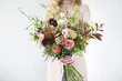 canvas print picture - Unusual wedding stylish bouquet in hands of a bride