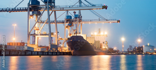 Photo Containers loading by crane in the morning , Trade Port , Shipping
