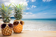 pineapple with sunglasses on wood,concept summer background.