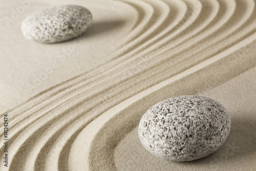 Foto op Plexiglas Stenen in het Zand Yin and yang Chinese Tao philosophy. Stones and sand pattern. Round rocks stand for Ying and jang in zen stone garden.