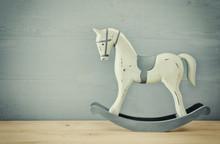 Vintage Rocking Horse On Wooden Floor