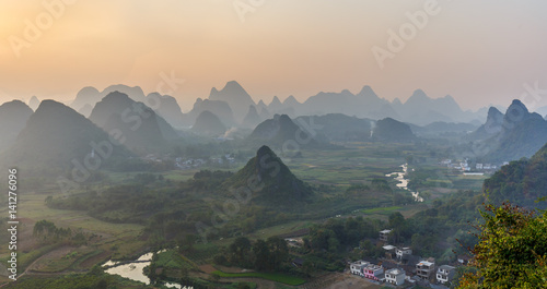 Staande foto Guilin Beautiful sunset. The view from the top of the Vine Mountains near Guilin - China