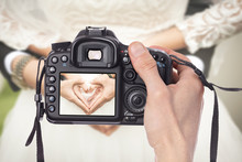 Professional Wedding Photographer Taking Pictures Of Bride And Groom