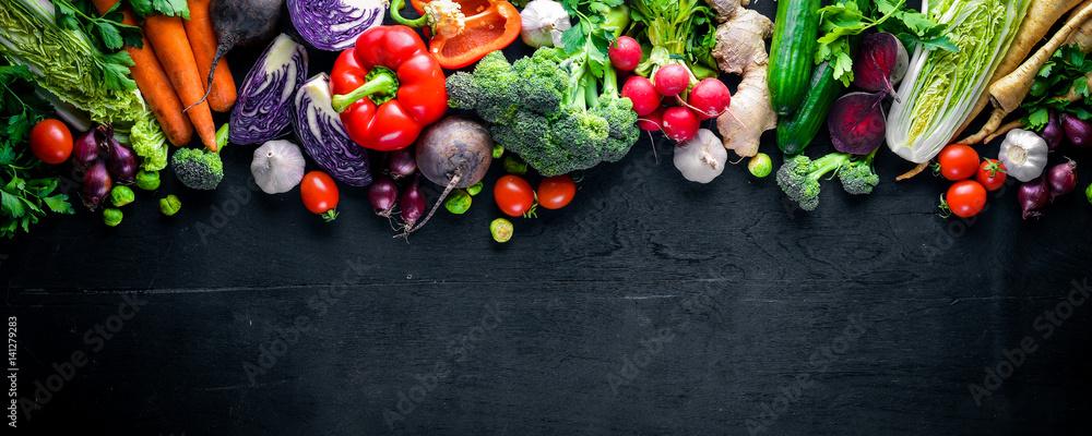 Fototapety, obrazy: Big set organic food. Fresh raw vegetables. On a black chalkboard.