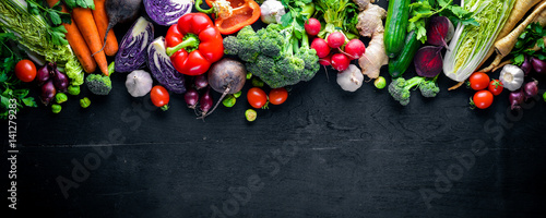 Fototapeta Big set organic food. Fresh raw vegetables. On a black chalkboard. obraz