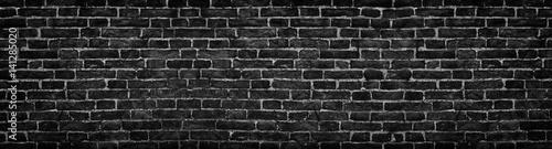 czarny-ceglany-mur-szeroka-panorama-jako-tlo