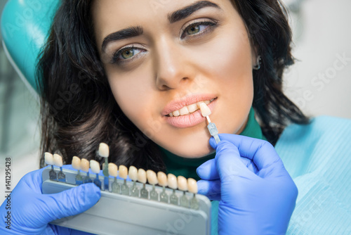 Dentist Holding Tooth Color Chart Face Of A Young Female Buy