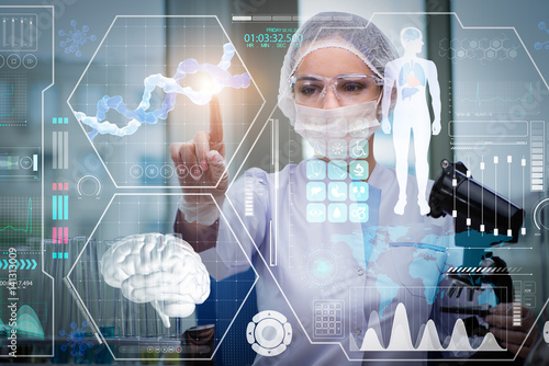Carta da parati Doctor in futuristic medical concept pressing button