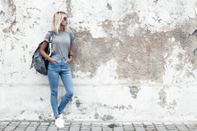 Model Posing In Plain Tshirt Against Street Wall