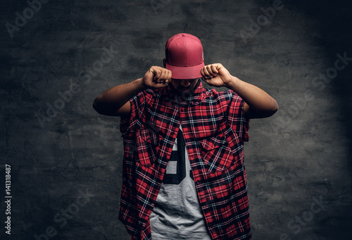 Fotografie, Obraz  Black bearded male dressed in a red fleece shirt and a cap.