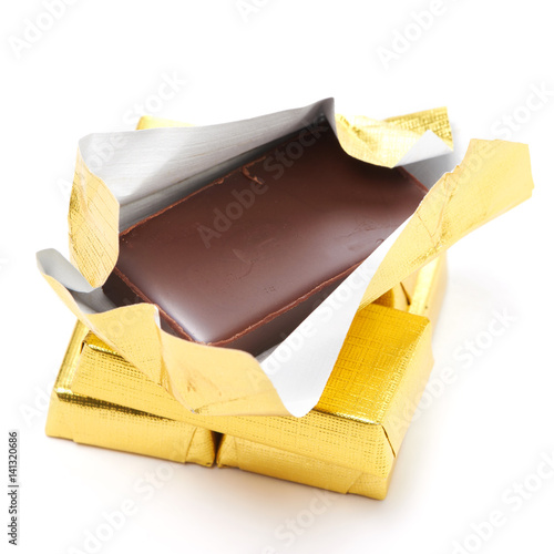 Vászonkép  Chocolate in gold wrappers isolated