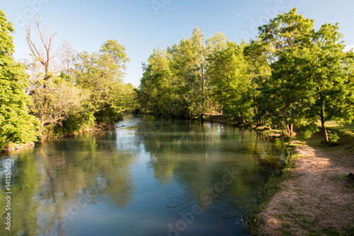 Photo Stands United States Park of the springs. Historic villa surrounded by woods and water