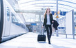 canvas print picture - young blonde business woman travel stock photo