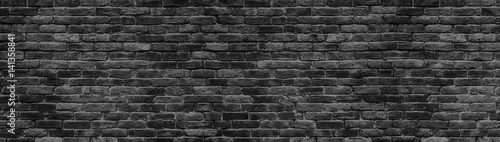 Fotografie, Obraz  black brick wall panoramic background for design