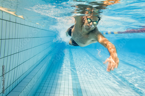 Fotografie, Obraz  Freestyle swimmer underwater in swimming lane