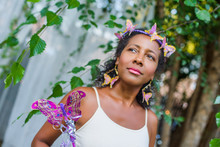 Portrait Of Mature Woman Wearing Butterflies In Her Hair