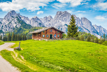 Traditional Wooden Mountain Chalet In Alpine Mountain Scenery