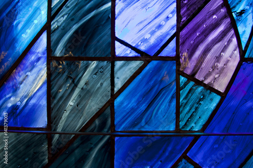 Fototapeta Beautiful shades of deep blue and purple on uniquely shaped stained glass window