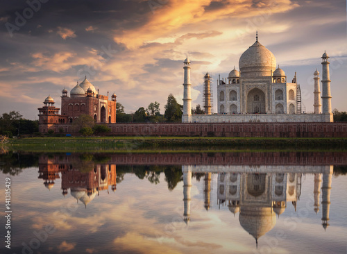 Foto op Plexiglas Artistiek mon. Taj Mahal at sunset as seen from Mehtab Bagh on the banks of the river Yamuna at Agra. Taj Mahal designated as a World Heritage Site is a masterpiece of Indian heritage and architecture.