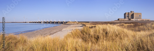 Tuinposter Dam Eastern Scheldt Storm Barrier at Neeltje Jans in The Netherlands