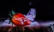 canvas print picture - eine künstlerische Darstellung einer aufgeschnittenen Erdbeere vor schwarzem Hintergrund mit Nebel