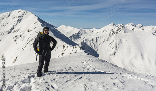Foto op Plexiglas Alpinisme Hiker with backpack during a winter trip in the mountains.