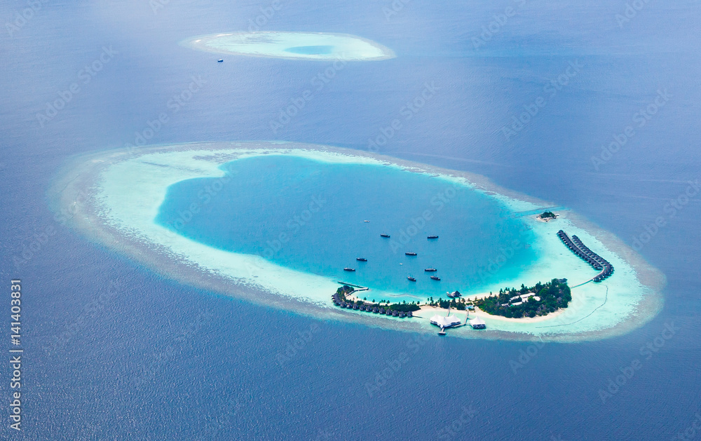 Fototapeta Aerial view from a seaplane of the Maldives atolls.