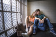 Young couple sitting on floor of staircase