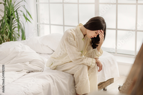 Disappointed asian woman showing agony Canvas Print