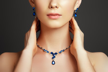 Beautiful Woman With A Sapphire Necklace. Fashion Concept