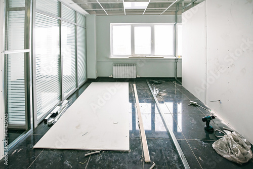 Fotografie, Obraz  repair in an office room (empty room with tools and building materials)