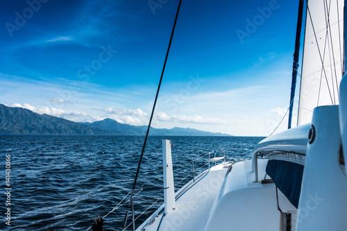 Tableau sur Toile Sailing yacht catamaran sailing in the sea. Sailboat. Sailing.