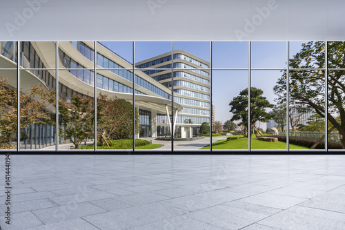 Fototapety, obrazy: The modern office buildings from glass window