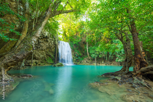 Poster Kaki Waterfall in Deep forest at Erawan waterfall National Park,