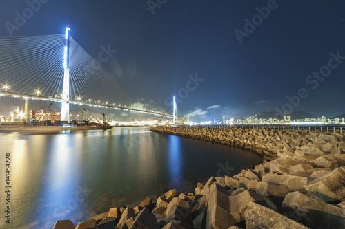 Suspension bridge and dam in Hong Kong harbor Poster