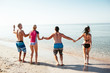 Friends on the beach. Have fun at sunny summer day
