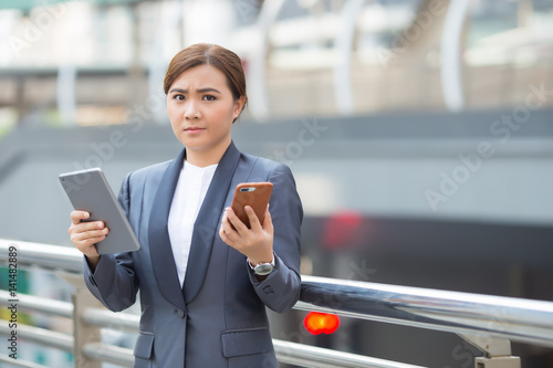 Businesswoman use tablet and smartphone has worry Canvas Print
