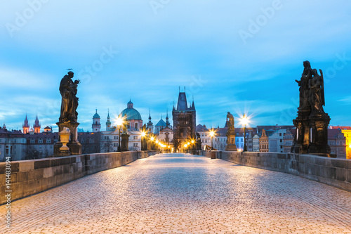 plakat Charles bridge, morning dusk scenery with street lights at blue sky background. Prague, Czech Republic.