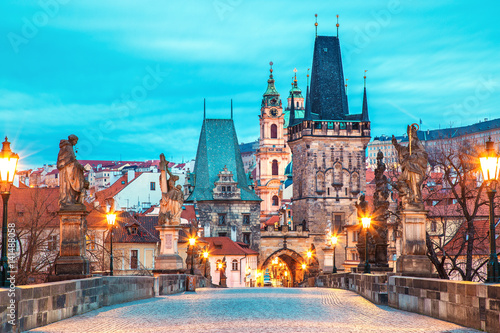 Wall Murals Prague Prague, Charles bridge, tower, the Church of St. Nicholas, Czech Republic. Twilight scenery. Popular European travel destination.