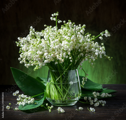 Poster Muguet de mai Lily of the valley bouquet on the wooden table.