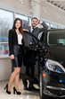 couple chooses the car in the showroom