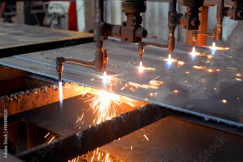 Photo Oxygen torch cuts steel sheet
